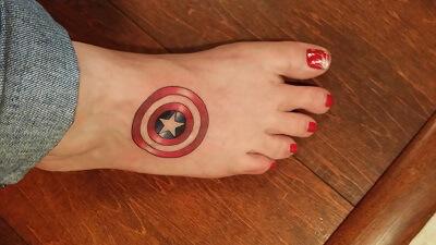 Cap shield tattoo